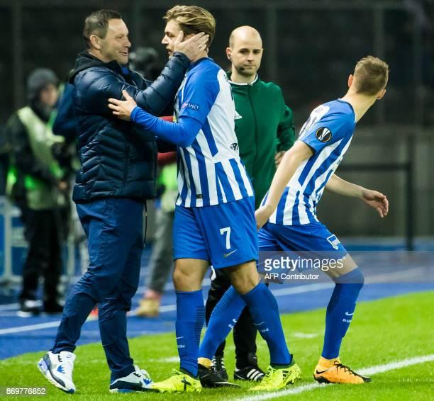 Hertha Berlin's Hungarian head coach Pal Dardai greets midfielder Alexander Esswein during the UEFA Europa League group J football match between...
