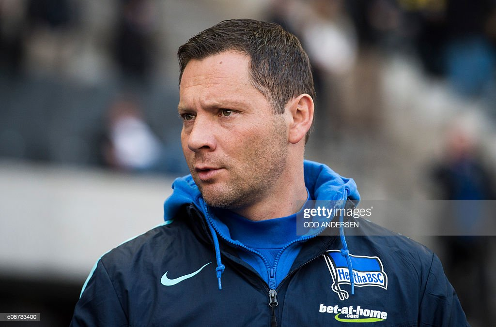 Hertha Berlin's Hungarian head coach Pal Dardai is seen prior to the German first division Bundesliga football match, Hertha Berlin v Borussia Dortmund, at the Olympic stadium in Berlin on February 6, 2016. / AFP / ODD ANDERSEN /