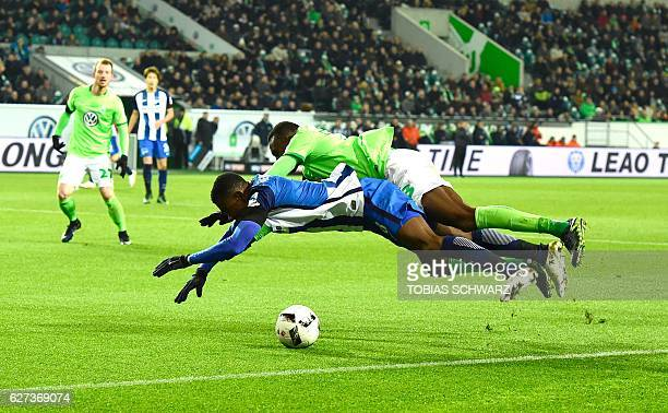 Hertha Berlin's Ivorian striker Salomon Kalou and Wolfsburg's French midfielder Josuha Guilavogui vie for the ball during the German first division...