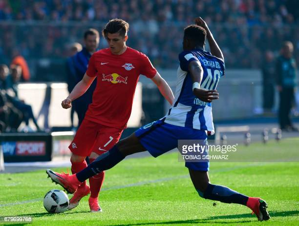 Hertha Berlin's Jordan Torunarigha and Leipzig's Marcel Sabitzer vie for the ball during the German First division Bundesliga football match between...
