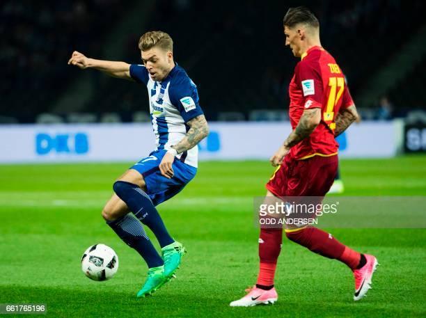 Hertha Berlin's midfielder Alexander Esswein and Hoffenheim's Swiss midfielder Steven Zuber vie for the ball during the German First division...
