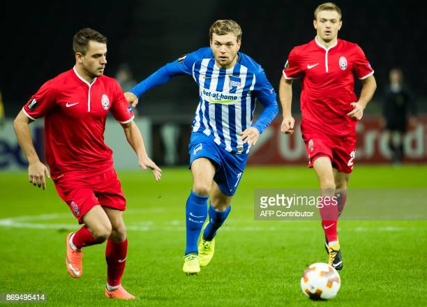 Hertha Berlin's midfielder Alexander Esswein Zorya's defender Artem Sukhotskiy and Zorya's midfielder Dmytro Grechyshkin vie for the ball during the...