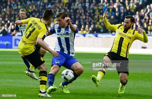 Hertha Berlin's midfielder Niklas Stark and Dortmund's Portuguese defender Raphael Guerreiro and Dortmund's midfielder Gonzalo Castro vie for the...