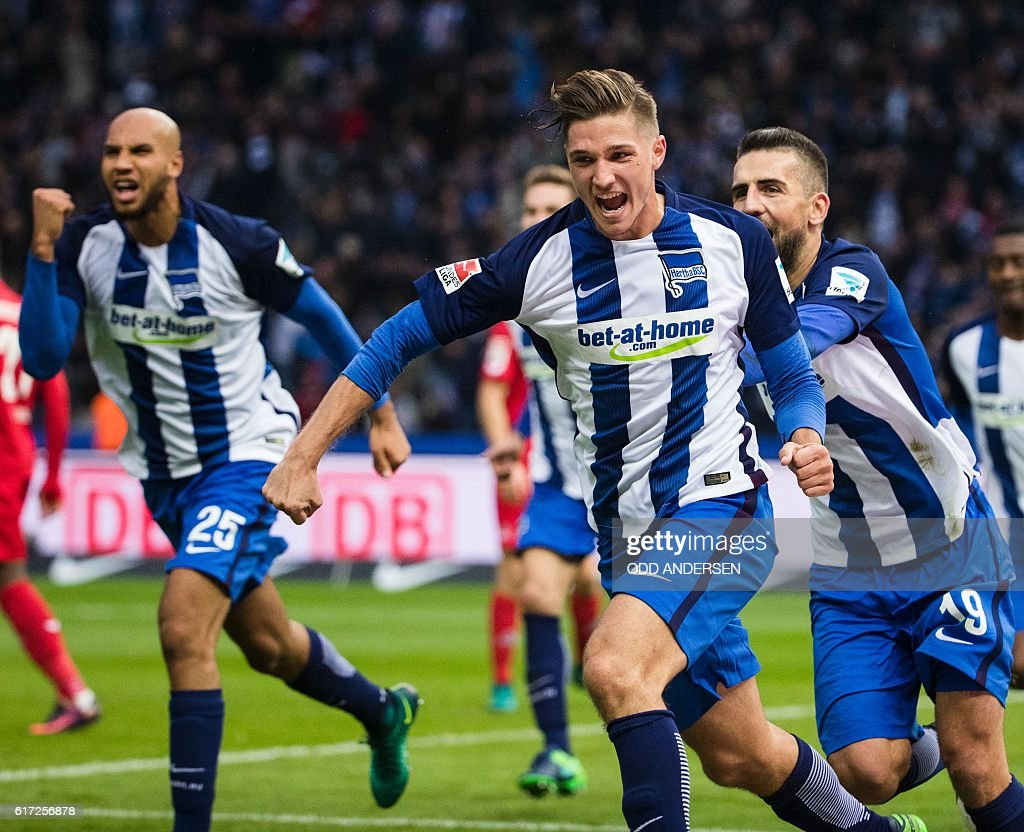 Hertha Berlin's midfielder Niklas Stark (front) celebrates scoring his side's 2nd goal during the German first division Bundesliga football match between Hertha BSC Berlin and FC Cologne in Berlin, on October 22, 2016. / AFP / Odd