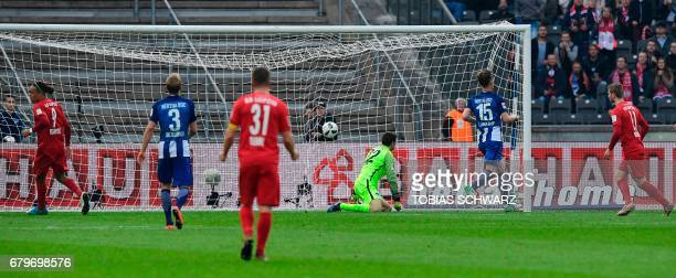 Hertha Berlin's Norwegian goalkeeper Rune Jarstein fails to keep the ball during the German First division Bundesliga football match between Hertha...
