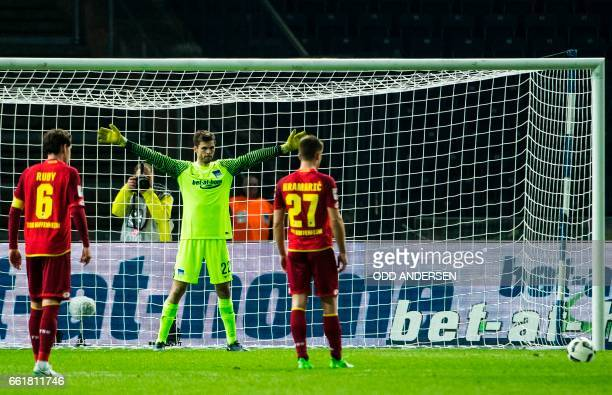 Hertha Berlin's Norwegian goalkeeper Rune Jarstein fails to save a penalty kick by Hoffenheim´s Croatian forward Andrej Kramaric during the German...