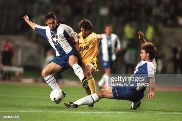 LR Hertha Berlin's Pal Dardai tries to tackle Chelsea's Gianfranco Zola with Hertha Berlin's Dick Van Burik