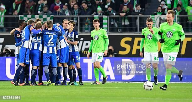 Hertha Berlin's players celebrate scoring during the German first division Bundesliga football match between VfL Wolfsburg and Hertha Berlin at the...