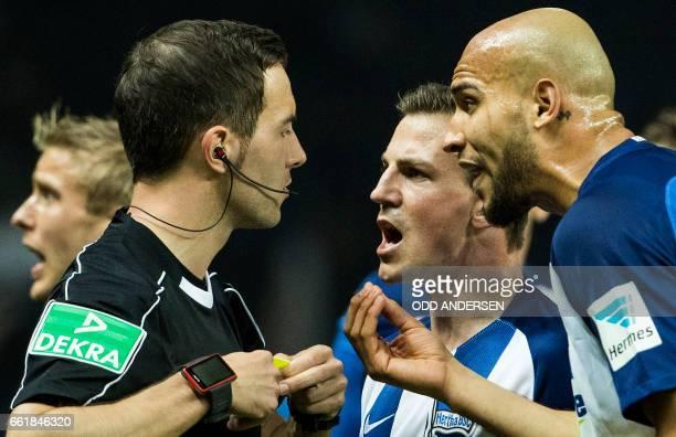 Hertha Berlin's Slovenian midfielder Vladimir Darida and Hertha Berlin's US defender John Anthony Brooks remonstrate with referee Benjamin Brand...