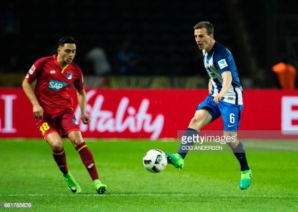 Hertha Berlin's Slovenian midfielder Vladimir Darida and Hoffenheim's midfielder Nadiem Amiri vie for the ball during the German First division...