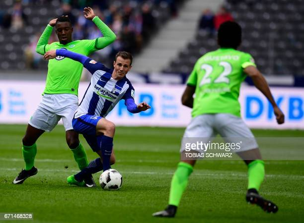 Hertha Berlin's Slovenian midfielder Vladimir Darida and Wolfsburg's Riechedly Bazoer vie for the ball during the German First division Bundesliga...