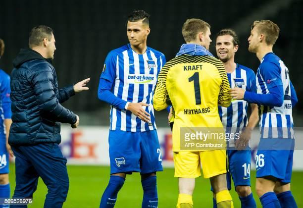 Hertha Berlin's two goals scorer forward Davie Selke celebrates at the final whistle with teammate goalkeeper Thomas Kraft Hungarian head coach Pal...