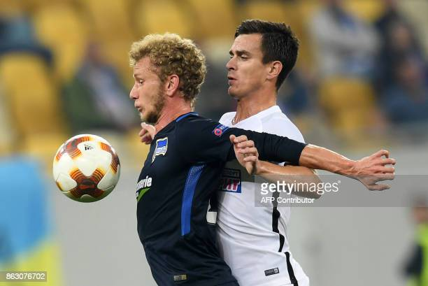 TOPSHOT Hertha BSC Berlin's Fabian Lustenberger vies with Zorya's Artem Gordiyenko during the UEFA Europa League Group J football match FC Zorya...