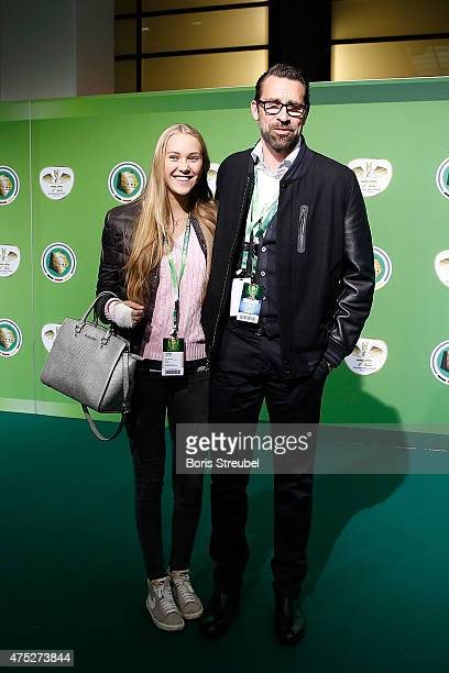 Hertha BSC sports director Michael Preetz and his daughter Alisa Preetz pose for a photo at the green carpet prior to the DFB Cup Final between...