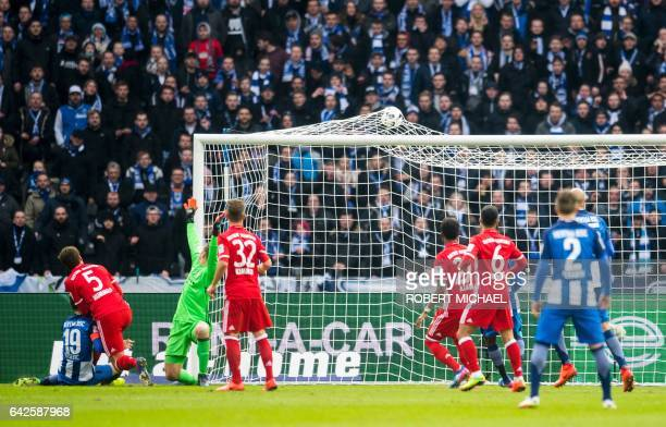 Hertha's Bosnian forward Vedad Ibisevic scores during the German First division Bundesliga football match Hertha Berlin vs Bayern Munich in Berlin...