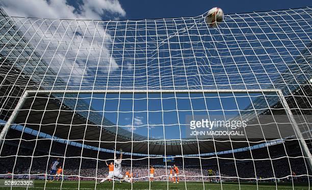 TOPSHOT Hertha's Czech midfielder Vladimir Darida puts the ball past Darmstadt's goalkeeper Christian Mathenia but the goal was disallowed during the...