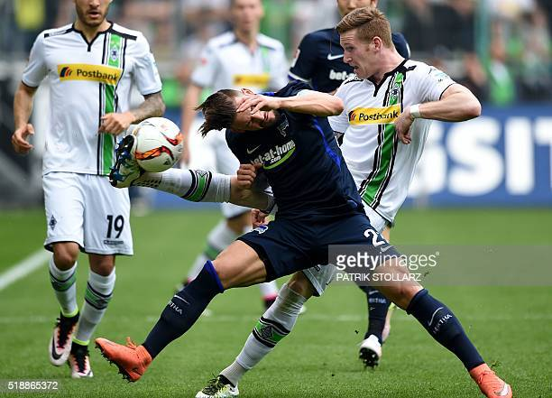 Hertha's defender Marvin Plattenhardt and Moenchengladbach's midfielder Andre Hahn vie for the ball during the German Bundesliga first division...