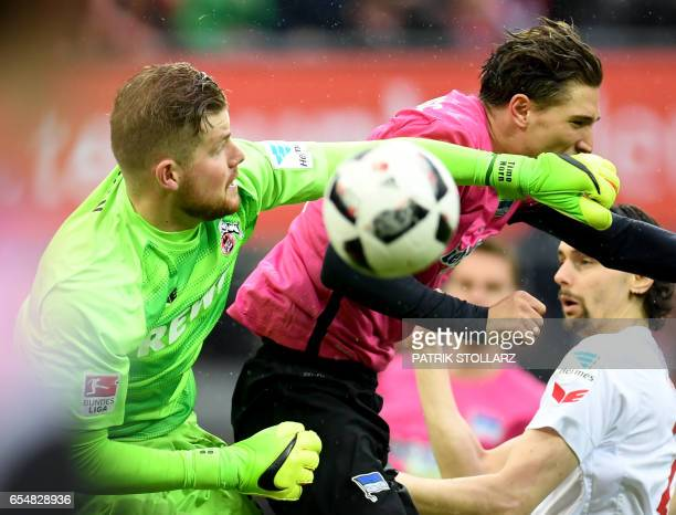Hertha's defender Niklas Stark and Cologne's goalkeeper Timo Horn vie for the ball during the German first division Bundesliga football match of 1FC...
