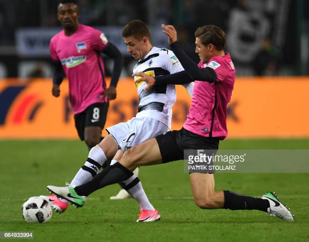 Hertha's defender Niklas Stark and Moenchengladbach's Belgian midfielder Thorgan Hazard vie for the ball during the German first division Bundesliga...