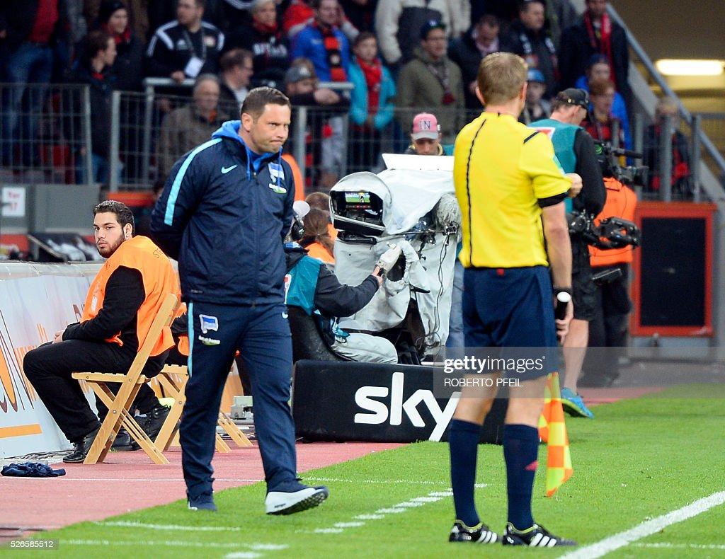 Hertha's Hungarian head coach Pal Dardai follows the action during the German first division Bundesliga football match Bayer 04 Leverkusen v Hertha Berlin in Leverkusen, western Germany, on April 30, 2016. / AFP / Roberto Pfeil