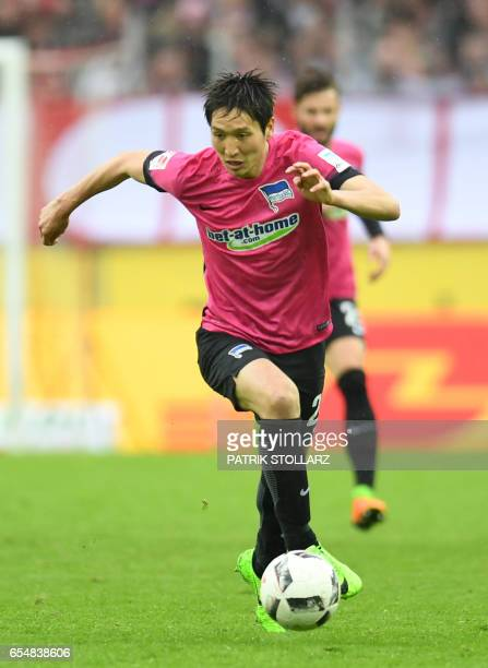 Hertha's Japanese midfielder Genki Haraguchi plays the ball during the German first division Bundesliga football match of 1FC Cologne vs Hertha BSC...