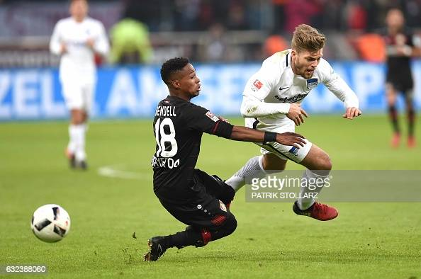 TOPSHOT Hertha's midfielder Alexander Esswein and Leverkusen's Brazilian defender Wendell vie for the ball during the German first division...