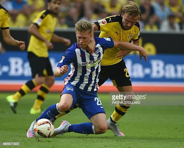 Hertha's midfielder Mitchell Weiser and Dortmund's defender Marcel Schmelzer vie for the ball during the German first division Bundesliga football...