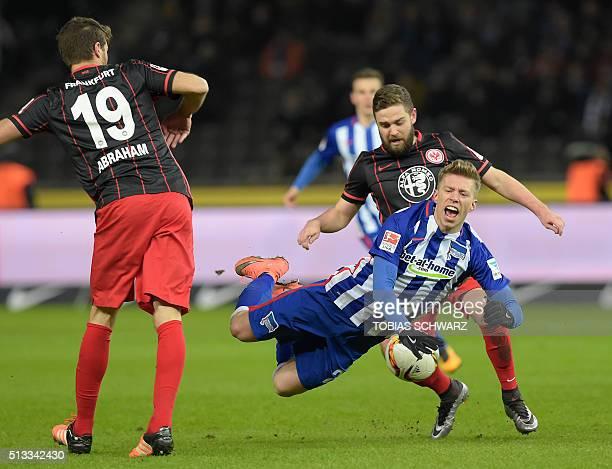 Hertha's midfielder Mitchell Weiser and Frankfurt's midfielder Marc Stendera vie for the ball during the German first division Bundesliga football...
