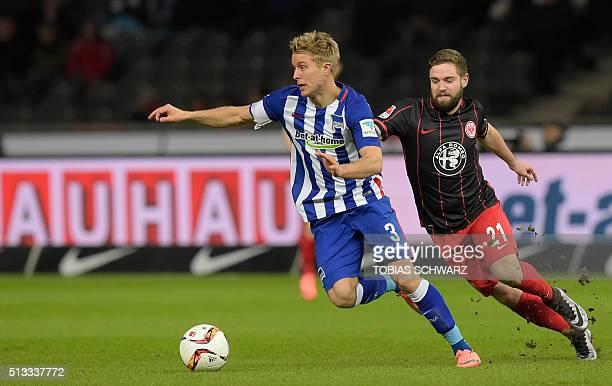 Hertha's Norwegian midfielder Per Ciljan Skjelbred and Frankfurt's midfielder Marc Stendera during the German first division Bundesliga football...