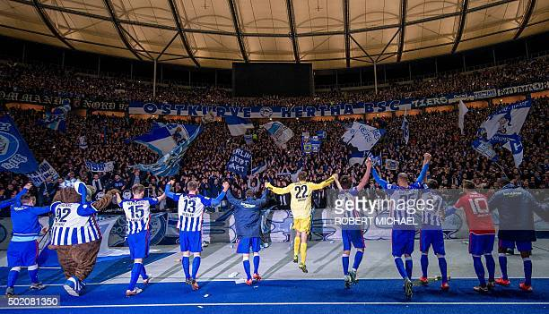 Hertha's players celebrate with their fans after the German first division Bundesliga football match Hertha BSC Berlin vs Mainz 05 on December 20...