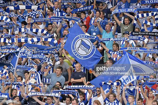 Hertha's supporters wave flags during the German first division Bundesliga football match FC Nuernberg vs Hertha Berlin in Nuremberg southern Germany...