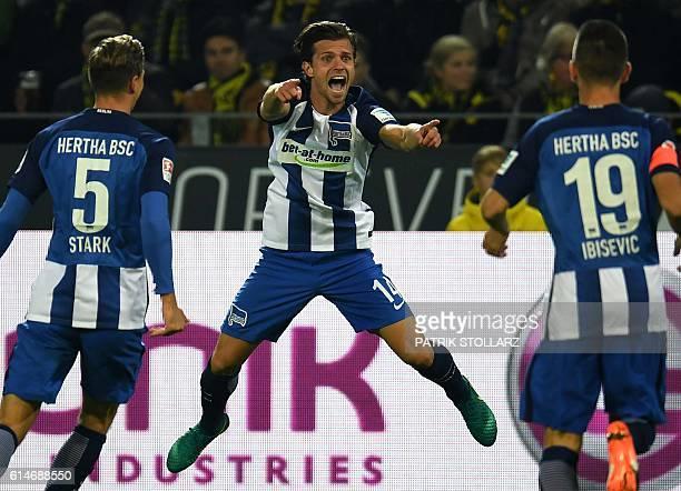Hertha's Swiss midfielder Valentin Stocker and his teammates celebrate scoring during the German first division Bundesliga football match between BVB...