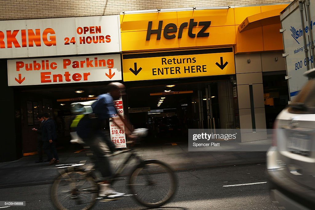 A Hertz car rental agency stands in Manhattan on June 30, 2016 in New York City. In an effort to expand its presence in the ride-hailing business, Hertz Global Holdings Inc. is expanding a car rental program to drivers working for Uber Technologies Inc. and Lyft Inc. Hertz currently has a network of 8,500 locations across the country.
