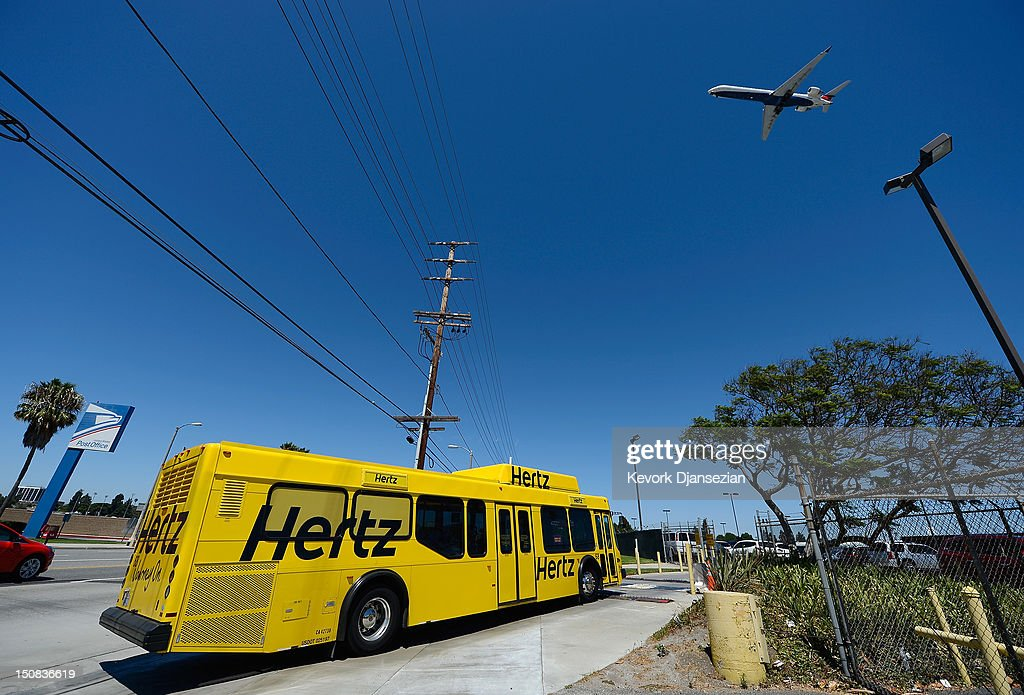 A Hertz Global Holdings car rental bus brings customers to Los Angeles International Airport branch August 27, 2012 in Los Angeles, California. Two major rental car companies agreed to merge as Hertz Global Holdings announced it is acquring Dollar Thrifty Automotive Group for $2.3 billion.