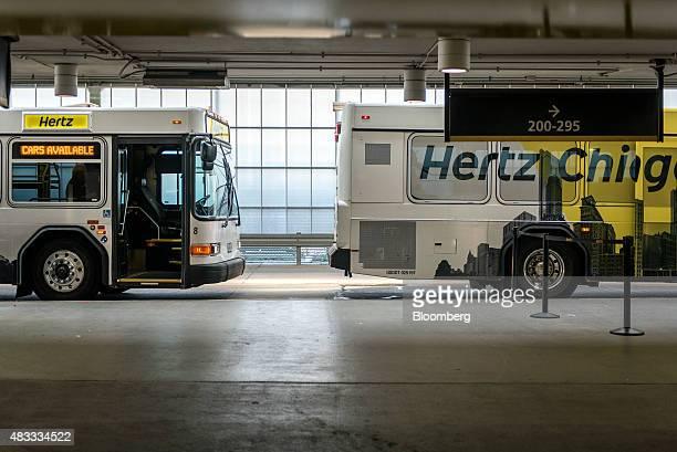 Hertz Global Holdings Inc shuttle buses wait to pick up travelers at O'Hare International Airport in Chicago Illinois US on Thursday Aug 6 2015 Hertz...