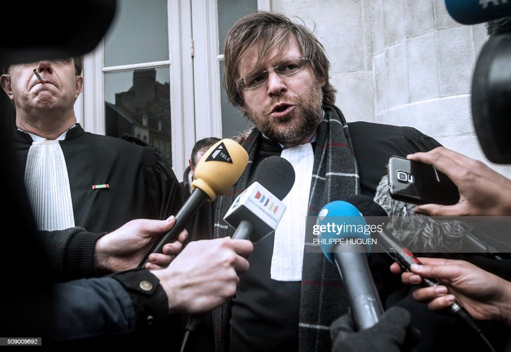 Herve Krych (L), one of the lawyers of French General Christian Piquemal accused of taking part in a banned anti-migrants demonstration, announces to the press the report of the trial for health reasons on February 8, 2016 at the courthouse of Boulogne-sur-Mer, northern France. French General Christian Piquemal is accused with four other of taking part in a banned anti-migrants rally called by Pegida (Patriotic Europeans Against the Islamisation of the Occident) movement. His trial is reported to May 12, 2016. / AFP / PHILIPPE HUGUEN