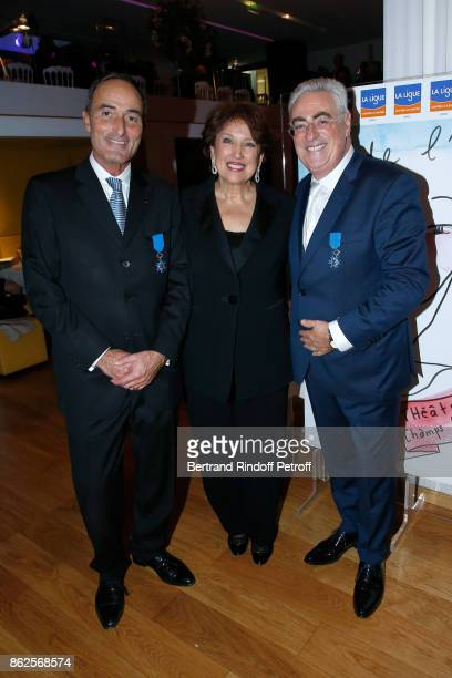 Herve MichelDansac and JeanMichel Aubrun received the insignia of 'Chevalier dans l'Ordre National du Merite' from Roselyne Bachelot Narquin during...