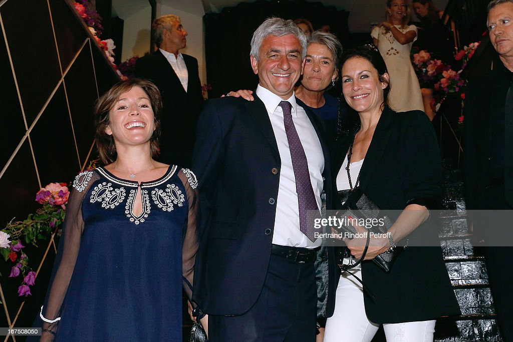 Herve Morin (C) with his wife Elodie Garamond (L) and Astrid Veillon (R) attend 'Les P'tits Cracks' - Charity Dinner At Pavillon des Champs Elysees on April 25, 2013 in Paris, France.