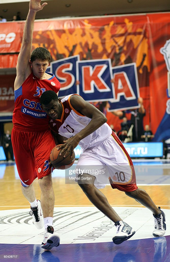 Herve Toure #10 of Lottomatica Roma competes with Viktor Khryapa #31 of CSKA Moscow during the Euroleague Basketball Regular Season 20092010 Game Day...
