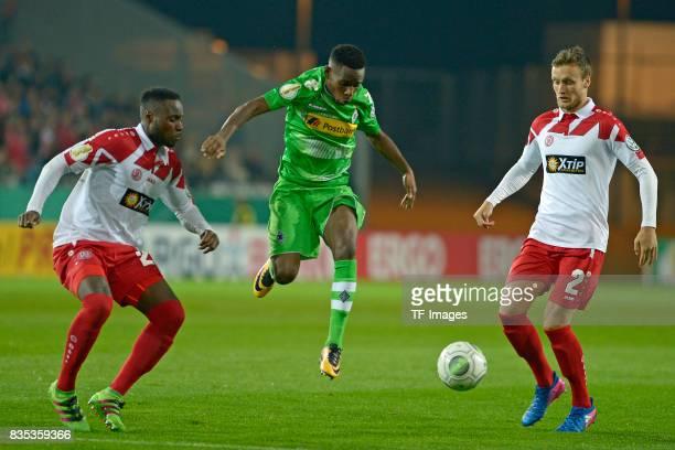 Hervenogi Unzola of Essen Ibrahima Traore / Traoré of Gladbach JanSteffen Meier of Essen during the DFB Cup match between Rot Weiss Essen and...