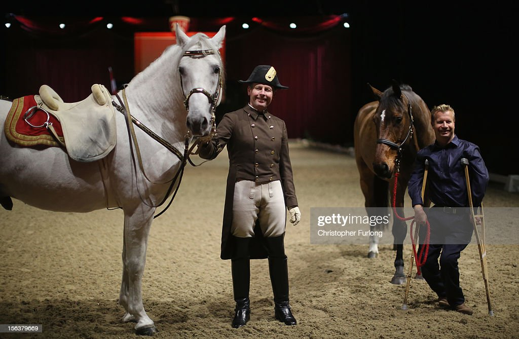 Herwig Radnetter, of The Spanish Riding School of Vienna, and his horse Pluto Sabata, pose alongside Paralympic dressage champion Lee Pearson and his horse Zion during a photocall at The National Indoor Arena on November 14, 2012 in Birmingham, England. The famous Spanish Riding School of Vienna's White Lipizzaner Stallions are performing with their skilled riders as part of their UK tour. Lee Pearson who has won 28 paralympic medals will also perform to show that disabled riders can also work in harmony with horses.