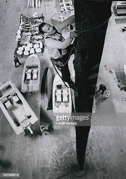MAY 2 1965 He's a High Light of Show Harold Johnson of Castle Rock Wash is all tied up in his work The world champion tree climber goes to the top of...