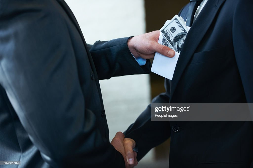 He's a rotten egg in the corporate world : Stock Photo