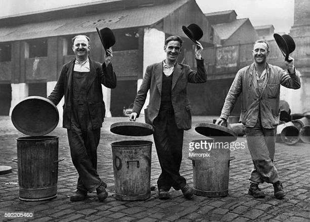 hese three happy dustmen latest recruits to the bowler hat Brigade found these bowlers outside an office in new market street Manchester and have...