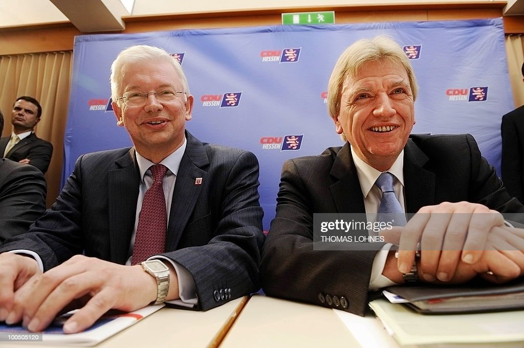 Hesse's State Premier Roland Koch (L) and Hesse's Interior Minister Volker Bouffier attend a meeting of the regional executive board on May 25, 2010 in Bad Nauheim, western Germany. The regional executive board discussed Koch's demission and his successor.