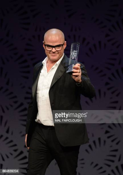 Heston Blumenthal claims the Diners Club Lifetime Achievement Award at the World's 50 Best Restaurants awards in Melbourne on April 5 2017...