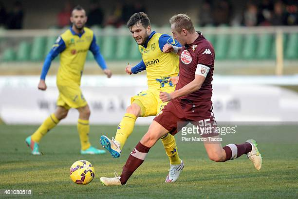 Hetemaj Perparim of AC Chievo competes for the ball with Glik Ksamil of Torino FC during the Serie A match between AC Chievo Verona and Torino FC at...
