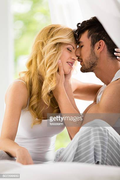 Heterosexual couple going to kiss