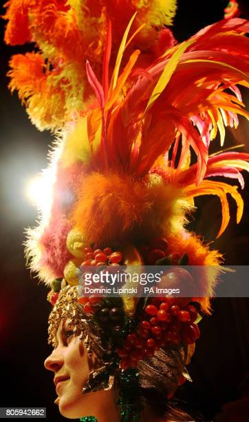 Hettie MacelleGifford wears a 'Carmen Miranda' headdress worn by female impersonator Danny La Rue part of a collection of his 90 costumes and gowns...