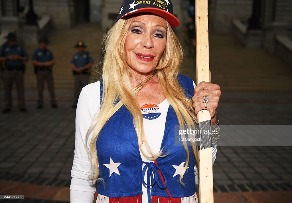 Hetty Hennessy, of Boulder, supporter of Donald J. Trump rallies outside the Colorado State Capitol in Denver, July 01, 2016. Trump was in Denver for the 7th annual Western Conservative Summit.